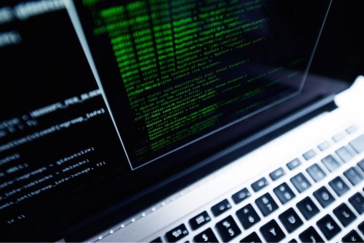 Laptop displaying computer code